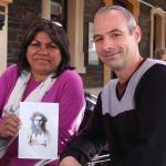 Image: Lynnette Wanganeen with Dr Chris Morton and copy of an 1867 photograph of her ancestor. Image courtesy: Pauline Cockrill and History SA.